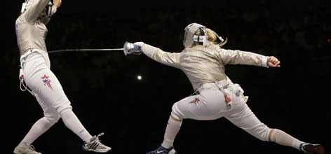 USA's Mariel Zagunis, right, scores against teammate Becca Ward in the semifinal round of the women's individual sabre.