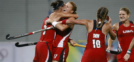 USA players Angela Loy, Carrie Lingo, Tiffany Snow and Keli Smith celebrate after scoring against Argentina during their women's preliminary field hockey match.