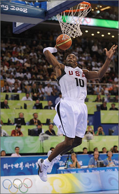 Kobe Bryant, dunking for two of his 13 points against China on Sunday, was one of four U.S. players to score at least 13 in a 101-70 win.