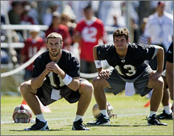 """The 49ers stripped Alex Smith, left, of his starting job and thrust him into a competition for the job with Shaun Hill, right, and J.T. O'Sullivan. Says offensive coordinator Mike Martz, """"Your quarterback has to be your best competitor on the field."""""""
