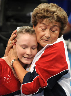Olympic gymnast Bridget Sloan, of Pittsboro, Ind., gets a hug from USA National Gymnastics Coordinator Martha Karolyi after her routine on the uneven bars on Sunday.