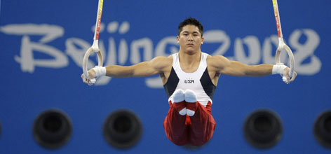 U.S. gymnast and team captain Kevin Tan performs at the rings in Beijing on Saturday. The rings specialist will be expected to help his team pull off an upset in the team finals.