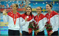Dara Torres, far left, shows off her silver medal with 4x100 relay teammates Kara Lynn Joyce, Natalie Coughlin and Lacey Nymeyer.