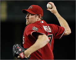 Arizona's Brandon Webb earned his major league-leading 17th win Sunday as the Diamondbacks beat the Atlanta Braves 6-1.