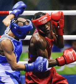 U.S. featherweight boxer Raynell Williams, right, had little trouble with Italy's Alessio di Savino Monday afternoon in Beijing in their first-round fight. Williams won 9-1 to advance to the second round.