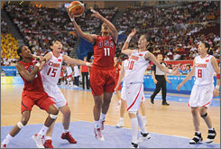 Tina Thompson goes hoop-ward to score two of her 27 points during the USA's 45-point rout of China. Sui Feifei, No. 10, and Chen Nan, left, are among the defenders as American Lisa Leslie follows the play.