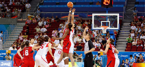 USA's Lisa Leslie goes up for the opening tip against Chen Nan of China. The USA beat China in a 108-63 rout, dashing all of the host nation's hopes for a court victory.