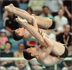 David Boudia and Thomas Finchum perform in the finals of the men's 10-meter synchonized diving finals on Monday in Beijing. The Indianapolis-based pair settled for fifth.
