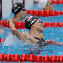 Natalie Coughlin reacts to her win in the women's 100 meter backstroke final on Tuesday morning.