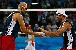 Phil Dalhausser and Todd Rogers of the United States celebrate a point and an eventual victory against the team from Switzerland.