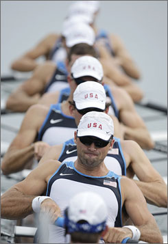 "USA's Marcus McElhenney, front, is the coxswain for the crew, which placed second in their men's heat. Bryan Volpenhein (behind McElhenney) says his team ""didn't push it too hard because we knew we'd have to race the next day."" They must finish in the top four Tuesday to advance to the final."
