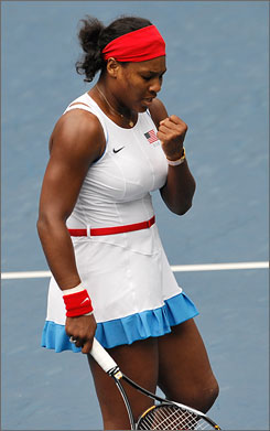 USA's Serena Williams reacts after smashing a return against Olga Govortsova of Bulgaria during her first-round victory at the Olympic tennis center in Beijing. The match started Sunday and was extended to Monday because of rain.