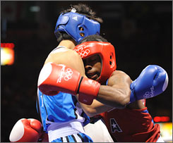 U.S. boxer Rau'shee Warren (red) is defeated by Korea's Oksung Lee in a 112-pound preliminary bout. Warren was the first American boxer in 30 years to qualify for consecutive Olympics and a favorite to win the gold medal.