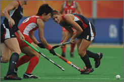 U.S. women's field hockey player Rachel Dawson chases down a loose ball during a match against Japan, Tuesday. The game closed in a 1-1 draw.