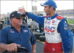 Darren Manning tries to explain his car's fate to team boss A.J. Foyt after dropping out of Saturday's 300-miler.