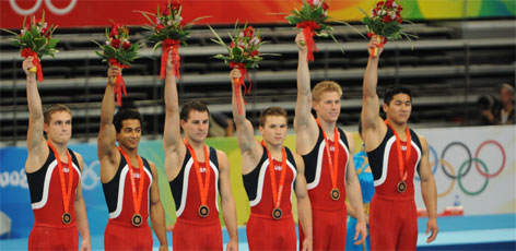 Sasha Artemev, left, helped secure Team USA's bronze medal finish with a crowd-pleasing finale on pommel horse.