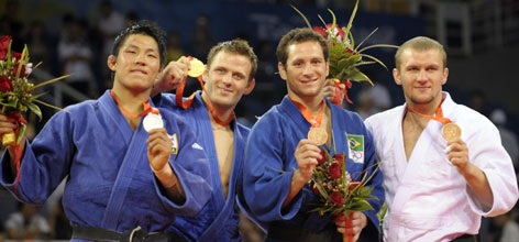 South Korean silver medalist  Jaebum Kim, left, German gold medalist Ole Bischof, and dual bronze medalists Tiago Camilo (Brazil) and Roman Gontiuk (Ukraine) pose on the podium after winning the men's 81-kg (178.5-pound) judo competition.