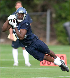 Seattle Seahawks wide receiver Courtney Taylor leaps to catch a pass thrown by quarterback Seneca Wallace during football training camp on July in Kirkland, Wash. Taylor moves into the Seahawks starting lineup with the injury to Bobby Engram.