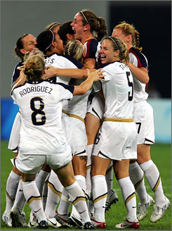 Heather O'Reilly (3rd right) of the U.S. celebrates with teammates during the women's match with New Zealand.