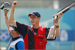 "Glenn Eller reacts as he wins the gold in the men's double trap shooting competition. ""It was a little dicey there for a second,"" Eller said. ""I knew exactly what I did wrong, so I just calmed myself down and made sure I went back through my routine, what got me into the final."""