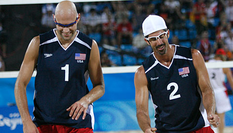 The United States' Phil Dalhausser, left, and Todd Rogers defeated Argentinean pair Martin Conde and Mariano Baracetti 21-12, 21-13 on Wednesday morning (Tuesday night ET). The men's beach volleyball competition moves to a single-elimination round of 16 on Friday.