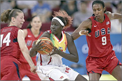 Americans Katie Smith, left, and Lisa Leslie shut down Mali's Aminata Sininta during their preliminary-round game Wednesday in Beijing. The U.S. won 97-41.