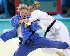 USA's Ronda Rousey (in blue) battles Germany's Annett Boehm in their 70kg Judo match. Rousey earned a bronze medal -- the USA's first medal in women's judo.