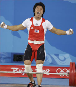 Sa Jae-hyouk of South Korea reacts after lifting 203 kg in the clean and jerk, to win the gold medal of the men's 77 kg weightlifting competition Wednesday.