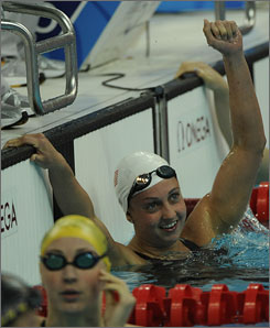 Rebecca Soni, right, set an Olympic record in the 200-meter breaststroke Wednesday with a time of 2 minutes, 22.17 seconds to break Amanda Beard's 2004 record.