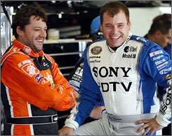 Tony Stewart, left, has hired fellow driver Ryan Newman, right, to drive the second car for his new team next season, according to AP sources.