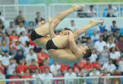U.S. divers Chris Colwill, front, and Jevon Tarantino compete during the men's synchronized 3m springboard. The pair placed fourth in the competition.