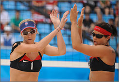Kerri Walsh, left, and Misty May-Treanor celebrate as the American pair finished their round-robin slate at 3-0 after dispatching Norway in straight sets.