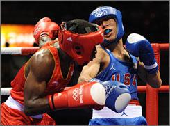 Team USA's Luis Yanez, in blue, battles Jose Kelvin de la Nieve of Spain in a 48-kilogram bout.