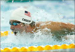"""Ian Crocker gets underway in the 100-meter butterfly, a race that could derail Michael Phelps' march toward eight gold medals. """"Crock's been waiting around for this event, so you know he's going to be ready to do something,"""" Phelps says."""