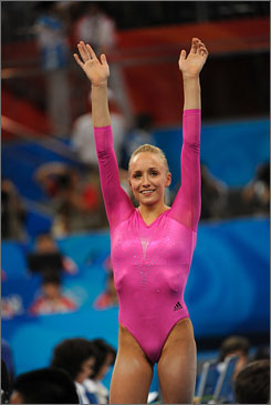American Nastia Liukin celebrates winning the women's all-around on Friday in Beijing. She edged teammate Shawn Johnson for the gold medal.