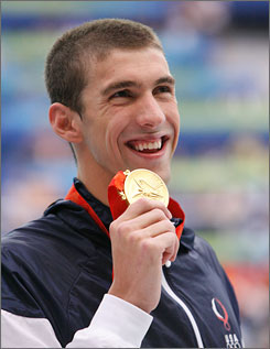"Michael Phelps' run of Olympic gold medals is ""history in the making,"" basketball star Kobe Bryant was told when he watched the swimmer win his fourth and fifth gold medals in Beijing."