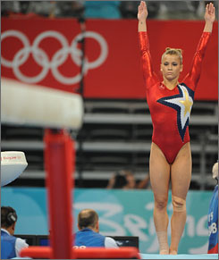 Alicia Sacramone prepares to mount the balance beam during the qualifications last weekend in Beijing.