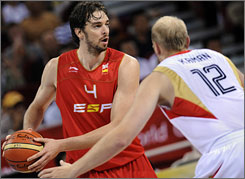 Spain's Pau Gasol (Los Angeles Lakers) is defended by Germany's Chris Kaman (Los Angeles Clippers) in the countries' game on Thursday in Beijing. The Spanish won 72-59 to up their record to 3-0 in the Olympic tournament.