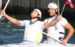 Pavol Hochschorner  and Peter Hochschorner of Slovakia celebrate after winning the 2008 Beijing Olympic Games Men's doubles Canoe C2 slalom final at the Shunyi Rowing and Canoeing Park in Beijing.