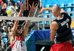Phil Dalhausser smashes the ball against Switzerland's Jan Schnider in their men's round of 16 beach volleyball match. Dalhausser and Todd Rodgers were down 0-6 when they waged their comeback.