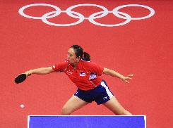 Gao Jun plays a shot against a Romanian during the bronze playoff round.