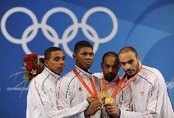 Jean-Michel Lucenay, Ulrich Robeiri, Jerome Jeannet and brother Fabrice Jeannet of France pose after winning gold in the men's team epee fencing competition at the Beijing 2008 Olympic Games.