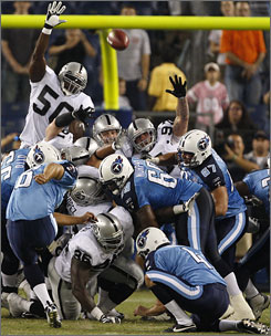 Titans kicker John Vaughn, who was filling in for All-Pro Rob Bironas, boots the game-winning 33-yard field goal as time expires against the Raiders.