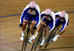 Chris Hoy leads his British teammates, Jason Kenny and Jamie Staff, to the men's team sprint gold medal over France and Germany.