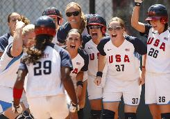 Teammates cheer Natasha Watley after a first-inning home run in the USA's 7-0 victory against Japan on Friday.