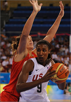 The USA's Lisa Leslie drives past Spain's Maria Pascua. The Americans won 93-55.