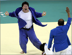 China's Tong Wen lets out a victory roar after being declared the gold medalist in the women's 78-kilogram weight class.