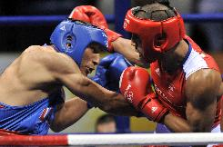 The USA's Shawn Estrada battles James DeGale in a middleweight Round of 16 match at the Workers Gymnasium.
