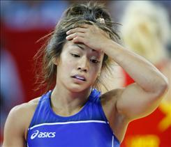 USA's Clarissa Chun reacts to losing her bronze medal match to Ukraine's Irini Merleni in their 105.5-pound freestyle wrestling match.