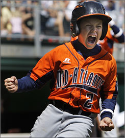 Hagerstown, Md., player Mark Grunberg lets loose after scoring the winning run against Indiana in the Little League World Series opener for both teams.
